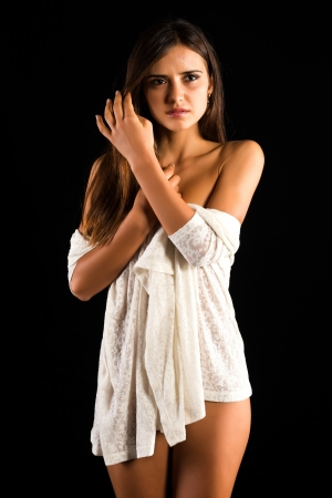 Beautiful slender nude Romanian brunette with a white sweater Stock fotó