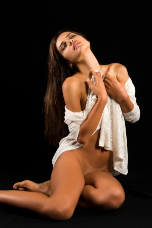 topless brunette: Beautiful slender nude Romanian brunette with a white sweater Stock Photo