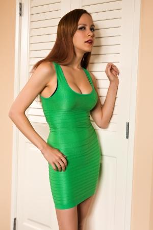 sheath: Pretty young redhead in a green sheath dress