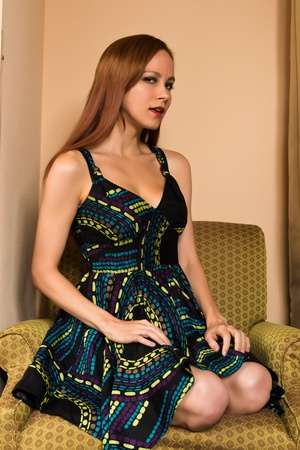 tall and short: Pretty young redhead in a print dress
