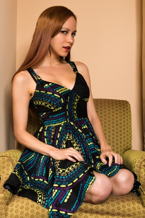 Pretty young redhead in a print dress