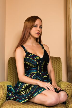 Pretty young redhead in a print dress Stock Photo - 15482857
