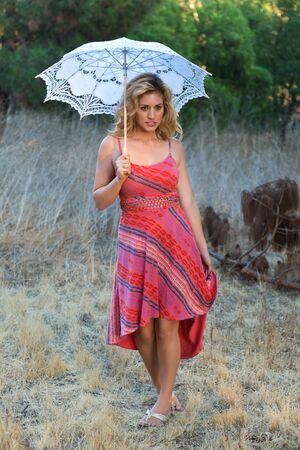 Beautiful tall blonde in a red sun dress