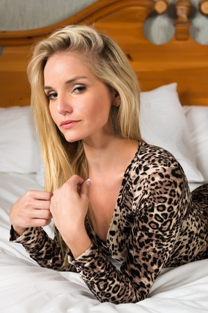 Pretty blonde woman in a leopard print dress photo