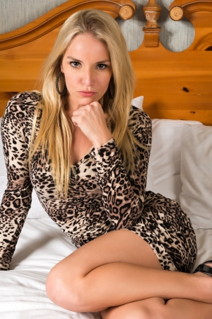 petite: Pretty blonde woman in a leopard print dress