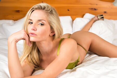 Pretty young blonde in metallic green lingerie photo