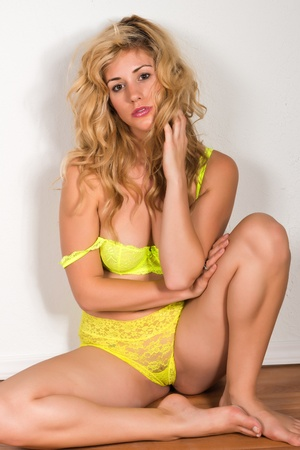 bra panties: Beautiful tall blonde dressed in yellow lingerie Stock Photo