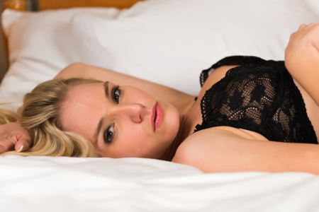 petite: Pretty young blonde dressed in black lingerie