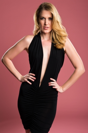Beautiful blonde in a black sheath dress photo