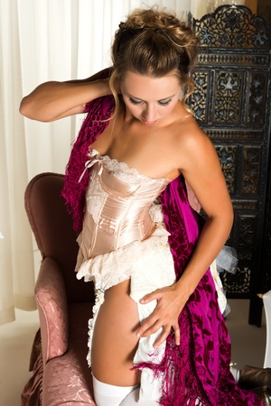 victorian lady: Pretty brunette dressed in a pink corset