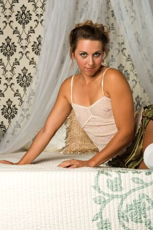Pretty brunette in a victorian bedroom photo