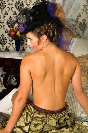 topless brunette: Pretty topless brunette in a victorian bedroom Stock Photo
