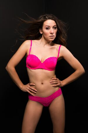 moldovan: Tall Moldovan woman in hot pink lingerie Stock Photo