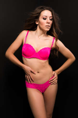 undergarment: Tall Moldovan woman in hot pink lingerie Stock Photo