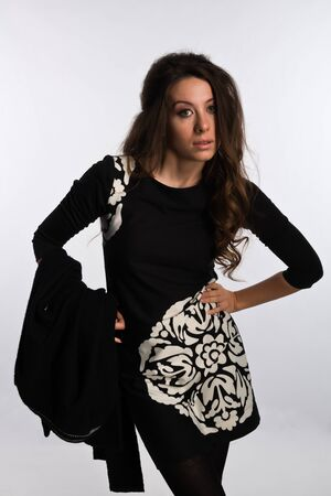 Tall Moldovan woman in a black dress and jacket