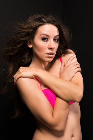 Tall Moldovan woman in hot pink lingerie photo