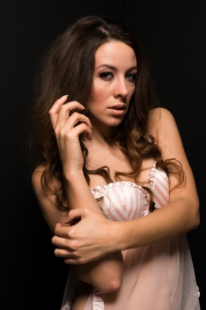 Tall Moldovan woman in pink and white lingerie photo