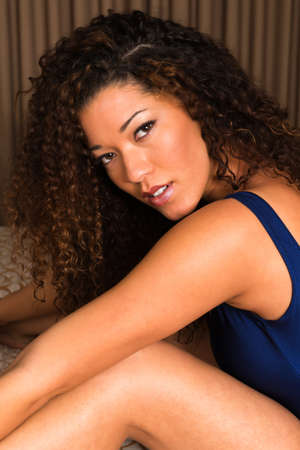 Beautiful wavy haired multiracial woman dressed in blue photo