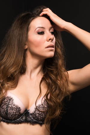 Tall Moldovan woman in pink and brown lingerie Stock Photo - 16431622