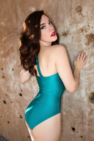Beautiful young redhead in a teal swimsuit