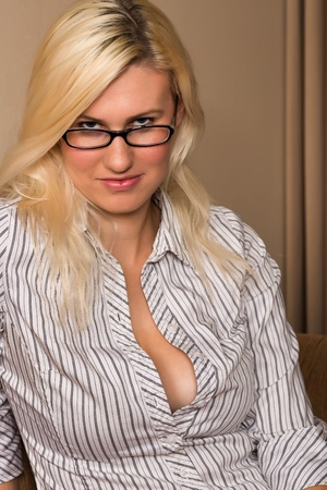 Tall young blonde in a striped blouse