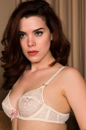 redhead lingerie: Pretty young redhead dressed in white lingerie Stock Photo