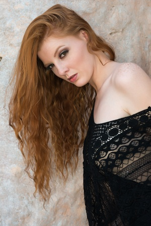 redhead lingerie: Tall young redhead dressed in black lingerie