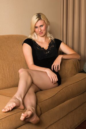 couches: Tall young blonde in a short black dress