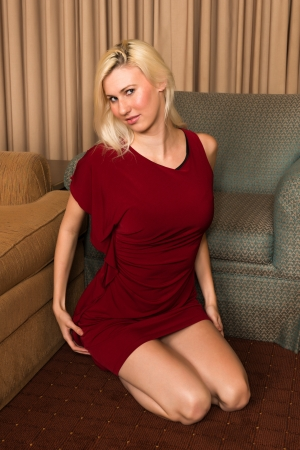 Tall young blonde in a dark red dress