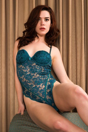 redhead lingerie: Pretty young redhead in a green bodysuit