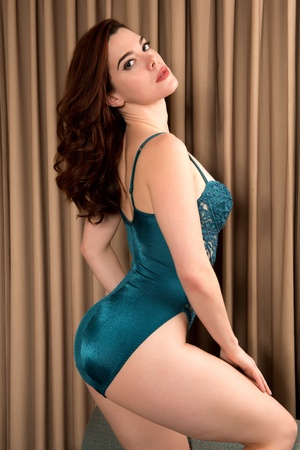 Pretty young redhead in a green bodysuit photo