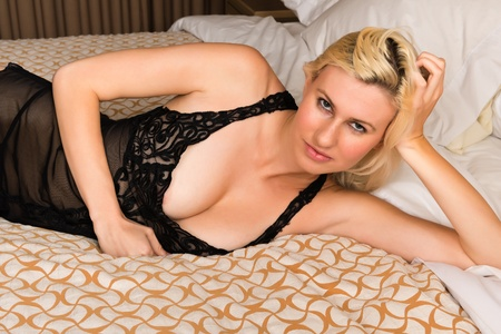 Tall young blonde dressed in black lingerie photo
