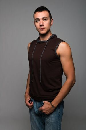 Handsome young man in a sleeveless hoodie photo