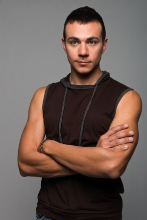Handsome young man in a sleeveless hoodie