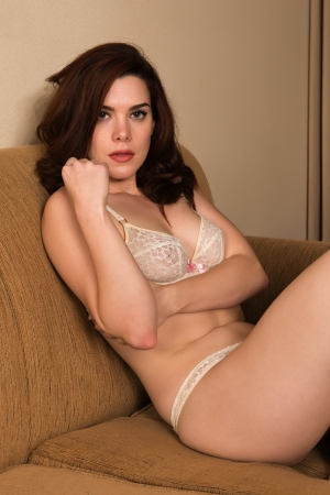 sexy bra: Pretty young redhead dressed in white lingerie Stock Photo