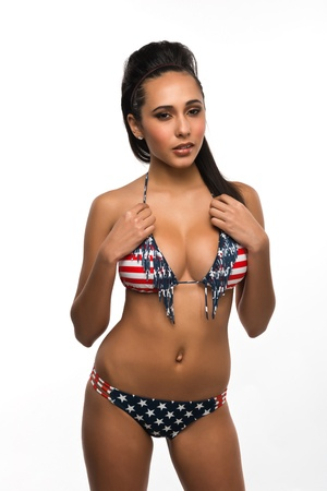 Beautiful young multiracial woman in a stars and stripes bikini Stock Photo