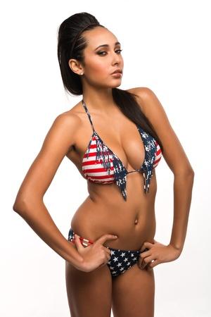 Beautiful young multiracial woman in a stars and stripes bikini photo