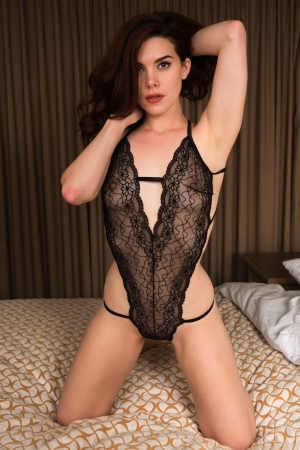 woman lingerie: Beautiful young redhead in sheer black lingerie