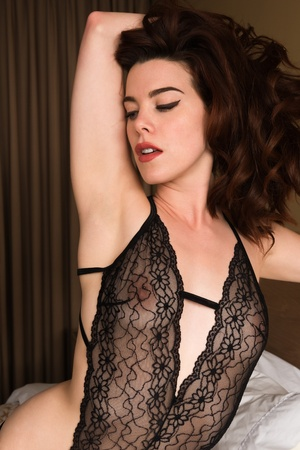 redhead lingerie: Beautiful young redhead in sheer black lingerie