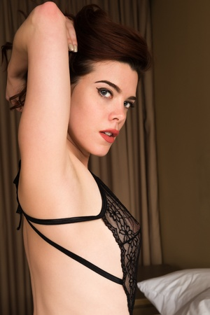 Beautiful young redhead in sheer black lingerie photo