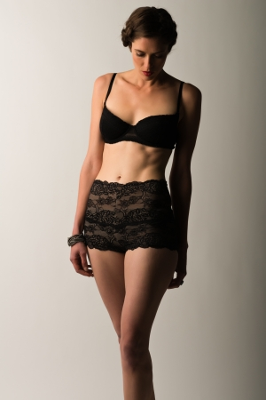 Tall slender brunette in vintage black lingerie photo