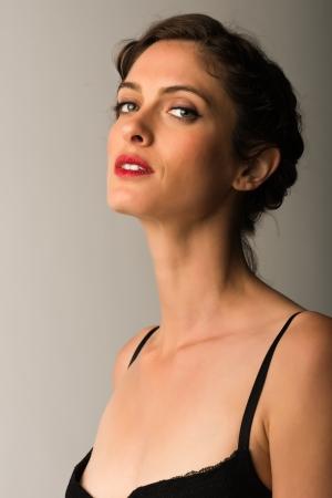sexy mature women: Tall slender brunette in vintage black lingerie Stock Photo