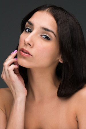 bare shoulders: Portrait of a slender young brunette with bare shoulders Stock Photo