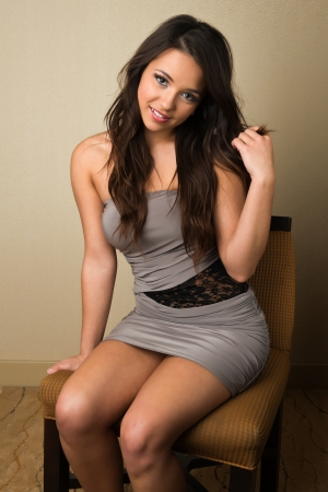 strapless dress: Pretty petite brunette in a strapless gray dress