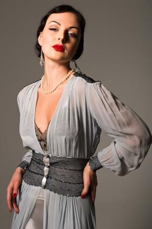 Beautiful young Ukrainian woman vintage gray gown photo