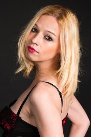 Pretty blonde woman in a red and black corset photo