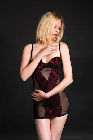 Pretty blonde woman in a red and black corset Stock Photo - 17538042