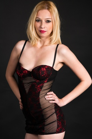 Pretty blonde woman in a red and black corset
