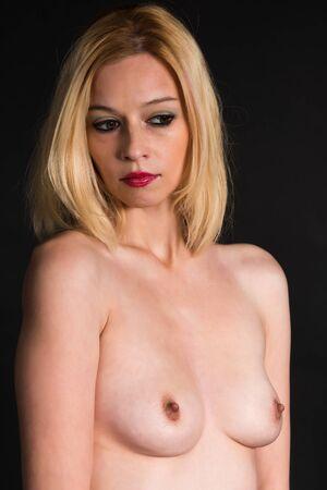 nude blonde woman: Pretty nude blonde woman on black