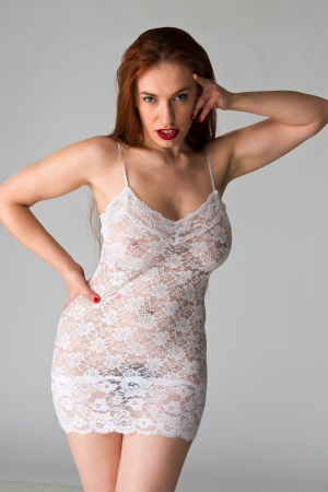 sheer: Pretty young redhead in a sheer white slip
